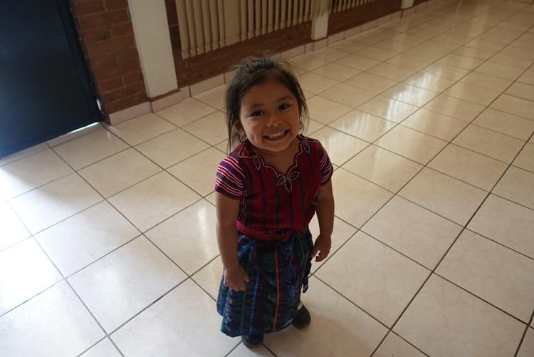 A child giggles in Guatemala by Lori Zaino