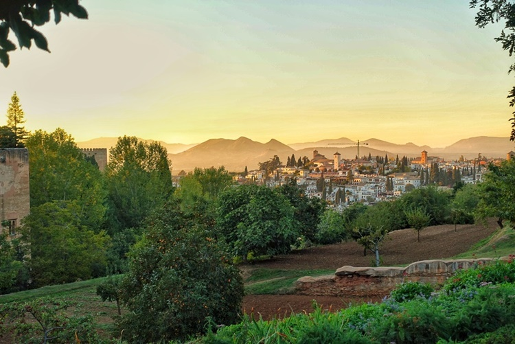 A SUNSET FROM THE ALHAMBRA GARDENS IN GRANADA SPAIN by Lori Zaino
