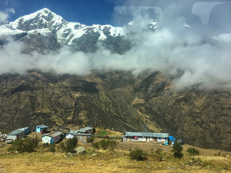 A small village in the Andean mountains of Peru by Lori Zaino