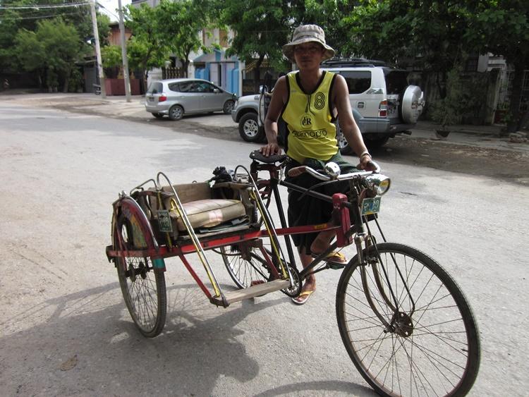 A taxi driver in Mandalay, Myanmar by Lori Zaino