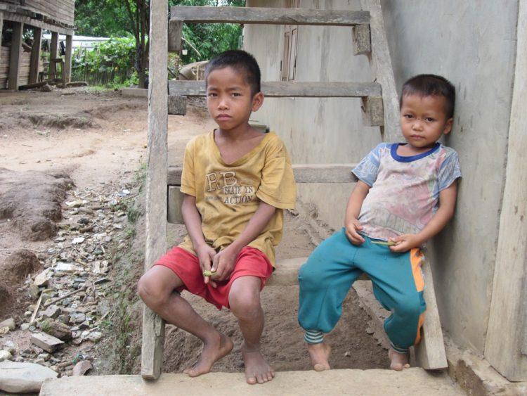Boys in a rural village along the Mekong in Laos by Lori Zaino