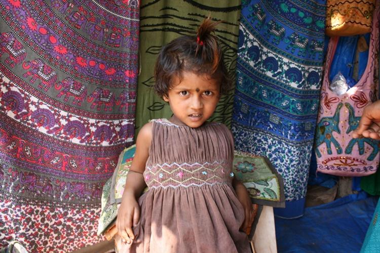A girl in a market in India by Lori Zaino