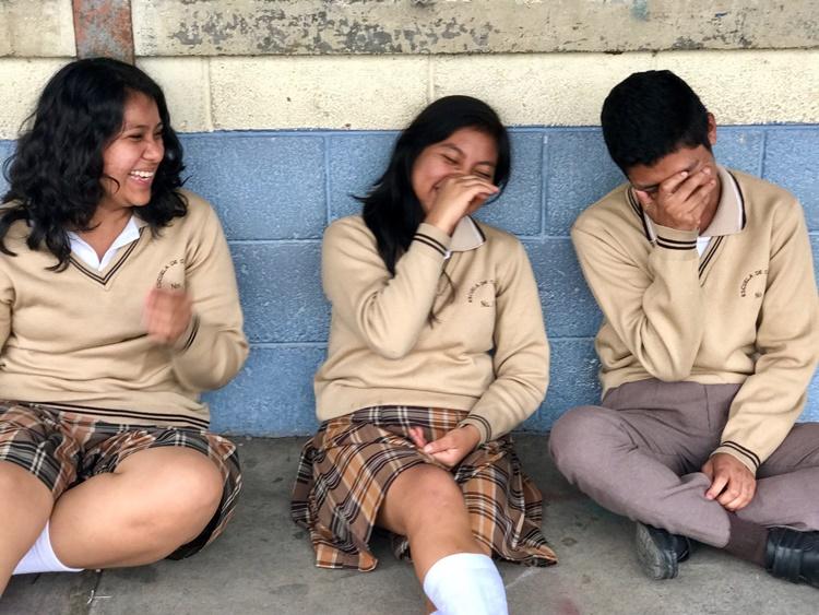 Teenagers laughing in Guatemala by Lori Zaino