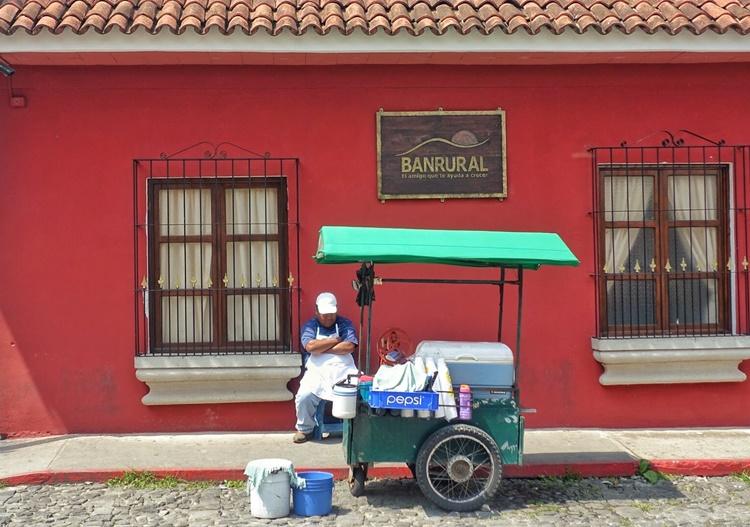 An ice cream vendor naps in Guatemala by Lori Zaino