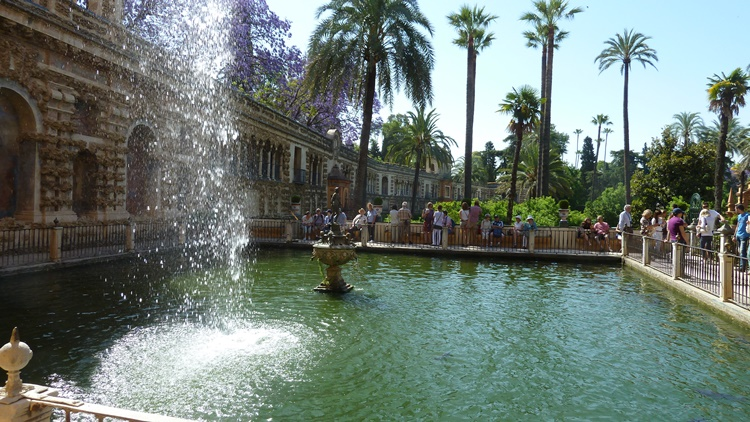 Water spurts at the Real Alcazar Gardens in Seville, Spain by Lori Zaino
